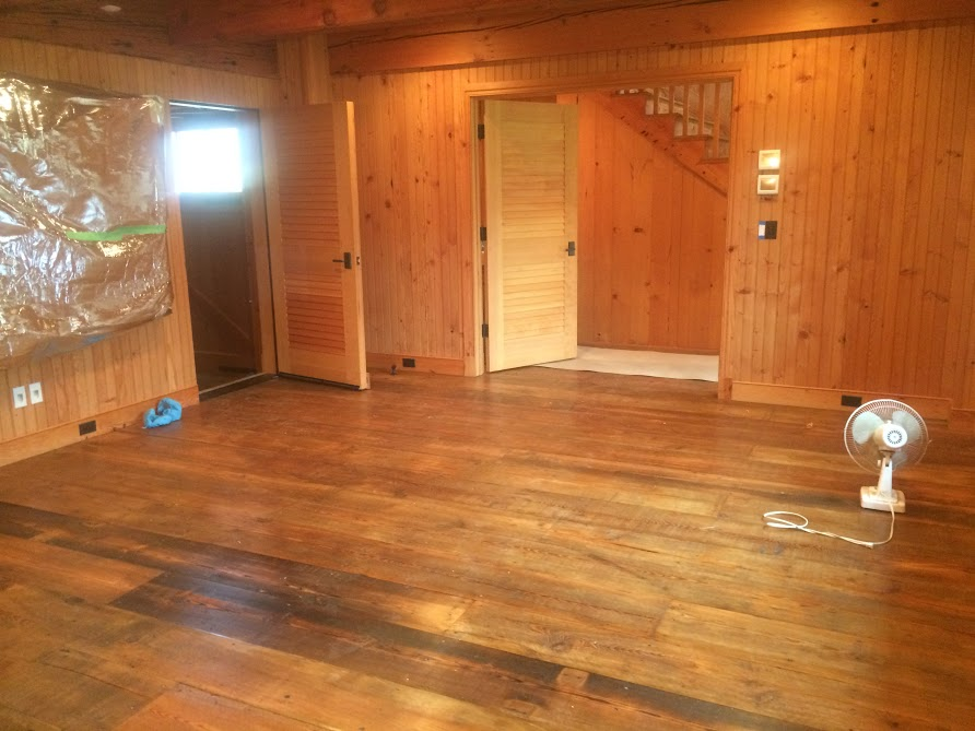 Installed reclaimed wall paneling and reclaimed wood floors in new home construction by the Housewright Shop