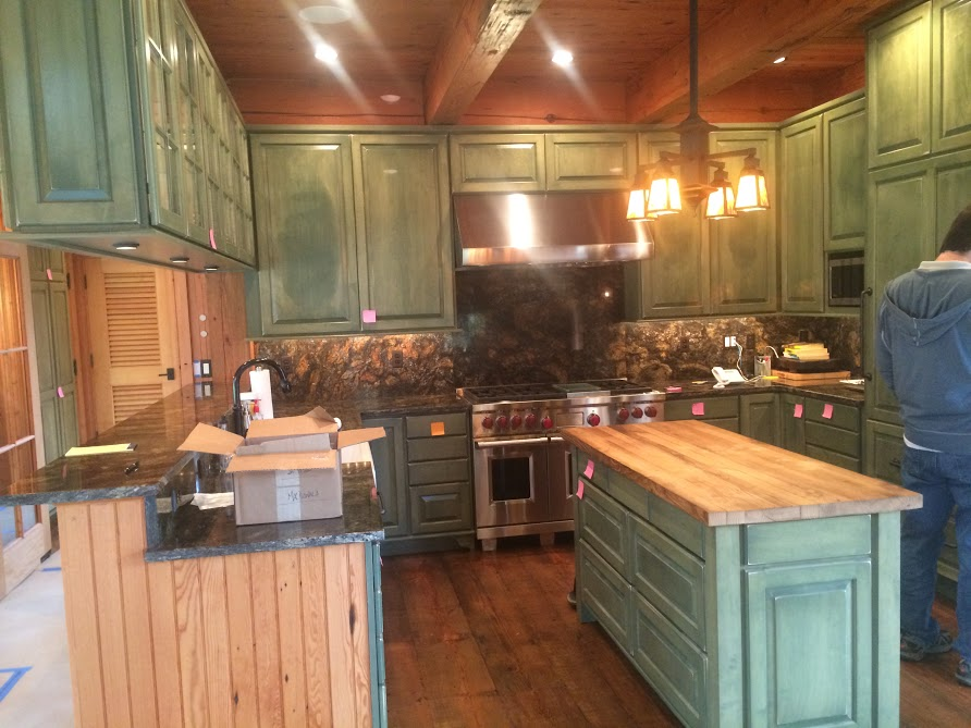New construction using reclaimed logs, reclaimed flooring, reclaimed doors, reclaimed materials by the Housewright Shop