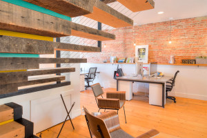 Installing reclaimed materials used as stairs and flooring in business office in Northern Virginia