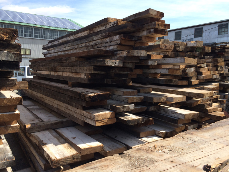 This is a stack of reclaimed boards, reclaimed beams, reclaimed logs by the Housewright Shop