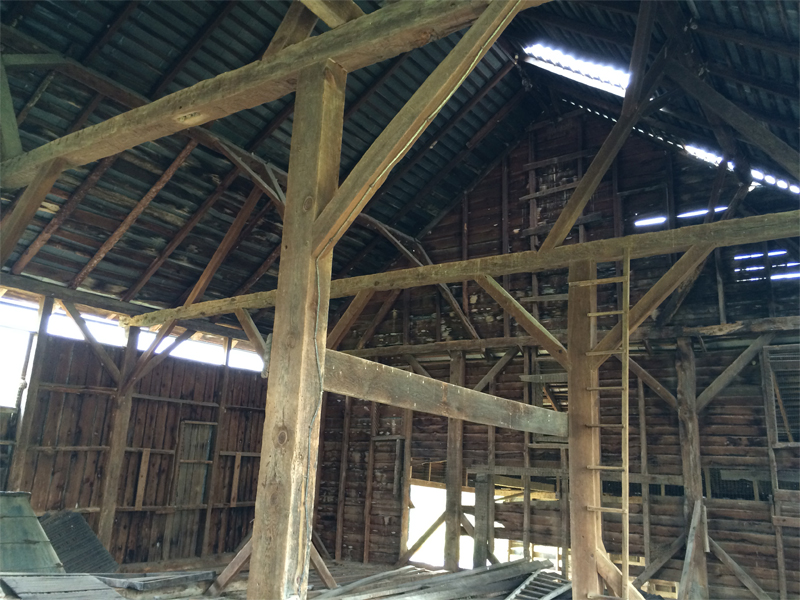 The Housewright Shop worked to reclaim the materials from this building that included, paneling, beams, logs and flooring