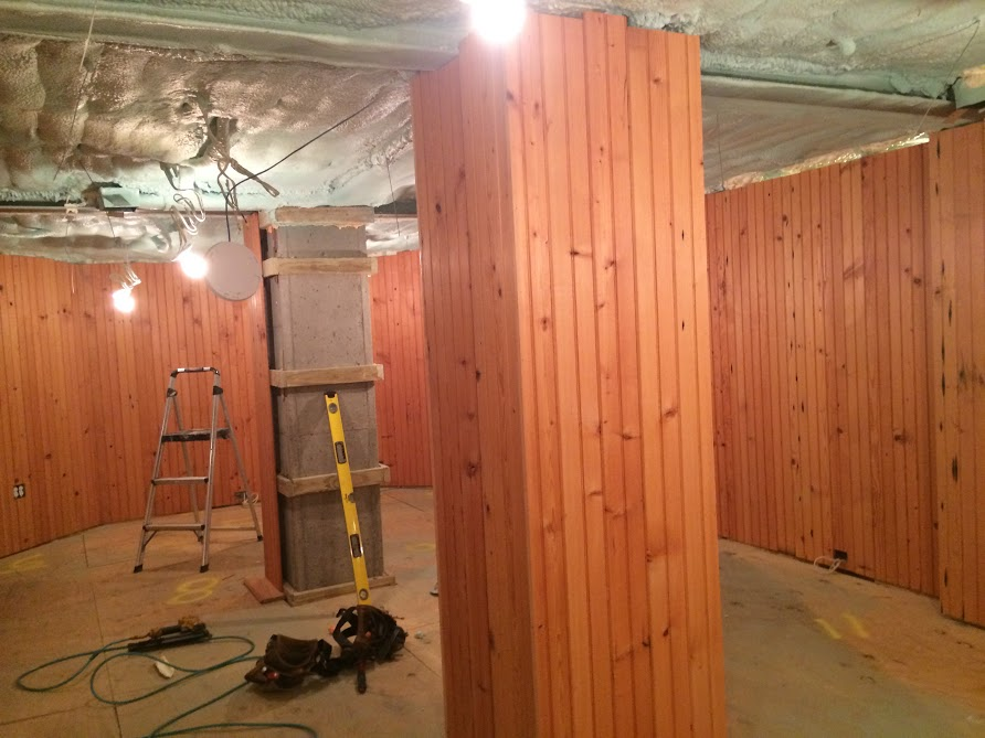 Installed reclaimed wall paneling in new home construction by the Housewright Shop