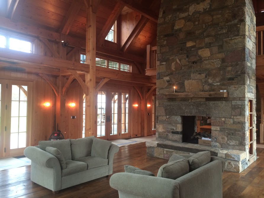 Installed reclaimed building materials that include reclaimed flowing, reclaimed stone, reclaimed logs, reclaimed beams