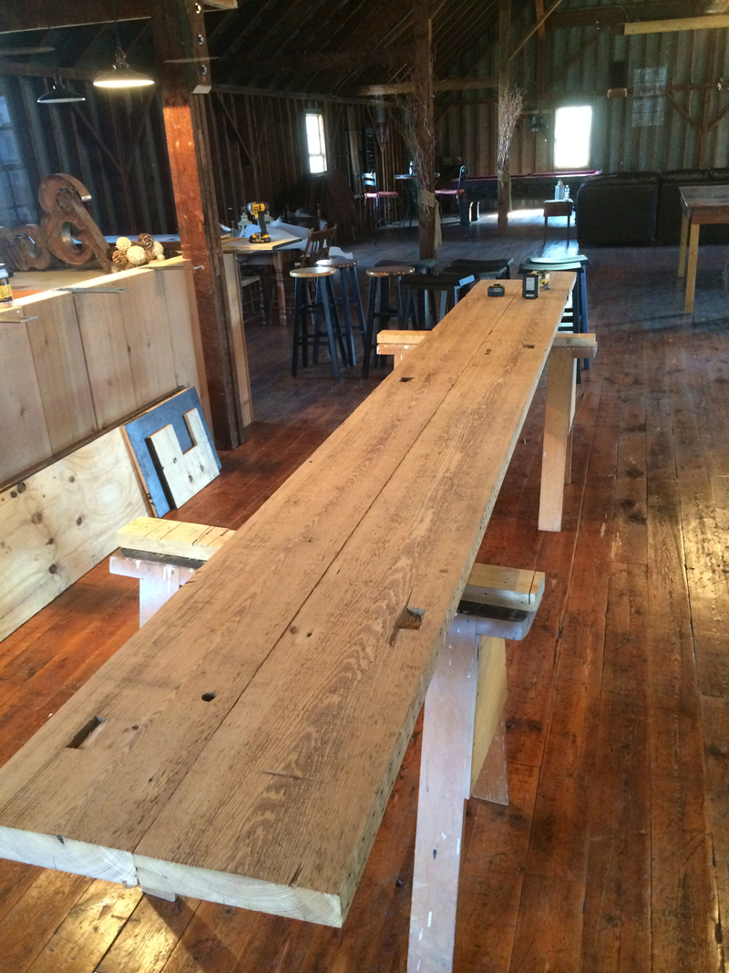 Reclaimed materials installed by The Housewright Shop. Materials include reclaimed beams, reclaimed paneling, reclaimed flooring.